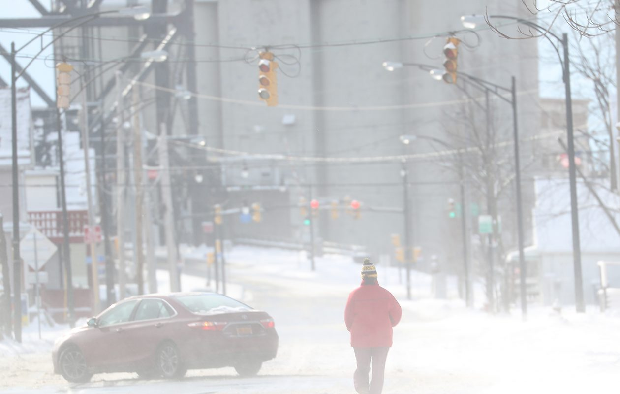 On a cold Christmas morning, a pedestrian walks down Louisiana Street in Buffalo. (Sharon Cantillon/Buffalo News)