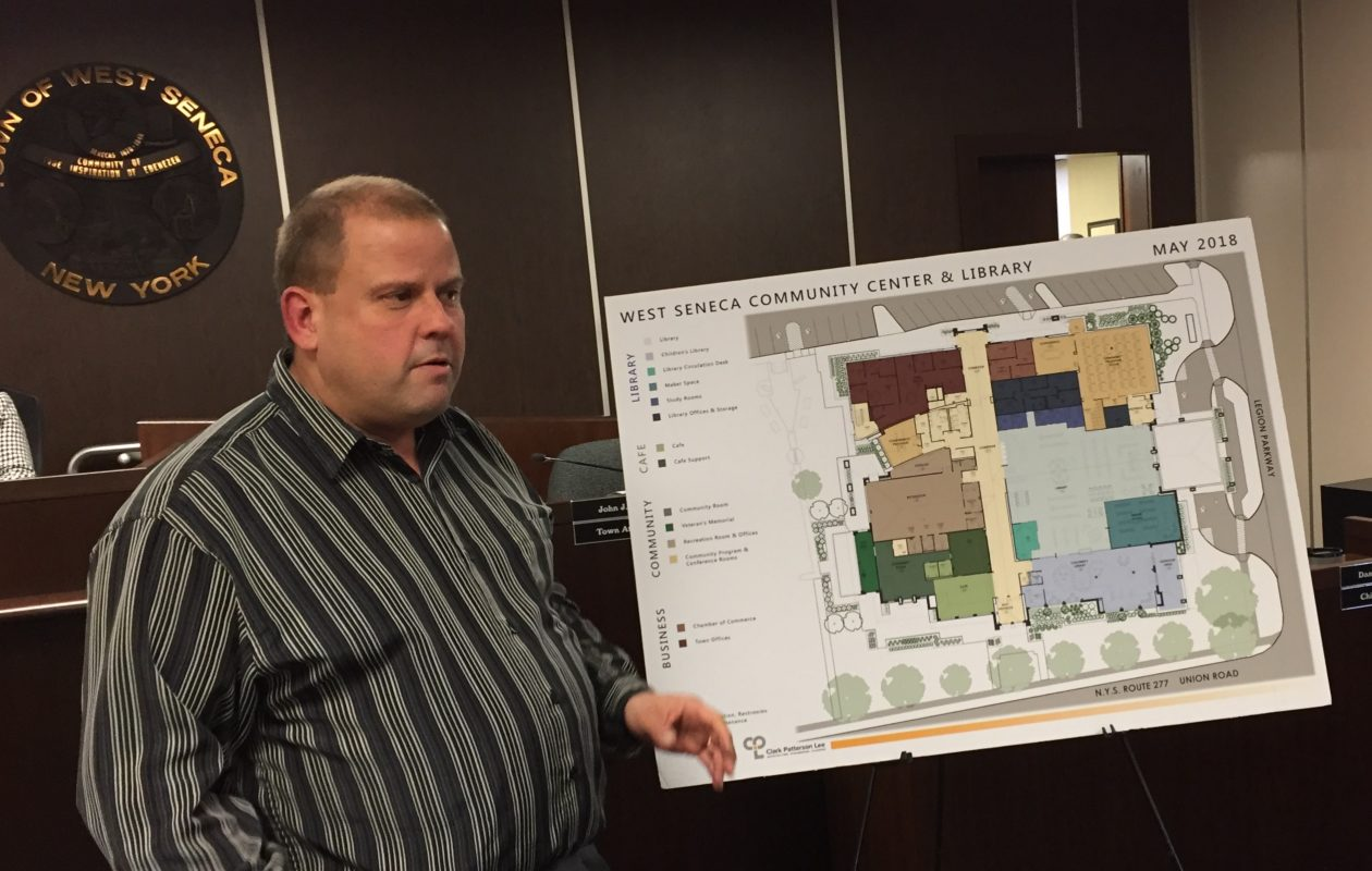 West Seneca Town Engineer Steve Tanner explains the layout in the new library/community center. (Barbara O'Brien/Buffalo News)