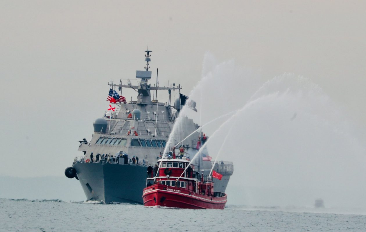 The Edward M. Cotter fireboat escorts the Navy's new USS Little Rock into the Buffalo Harbor on Monday, Dec. 4, 2017.  Sharon Cantillon/News file photo)