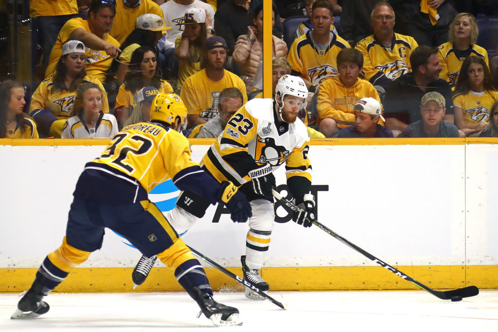 Scott Wilson works the puck against Nashville's Frederick Gaudreau during Game 3 of the Stanley Cup final last June. Wilson will wear No. 20 in his Sabres debut tonight in Denver. (Getty Images)