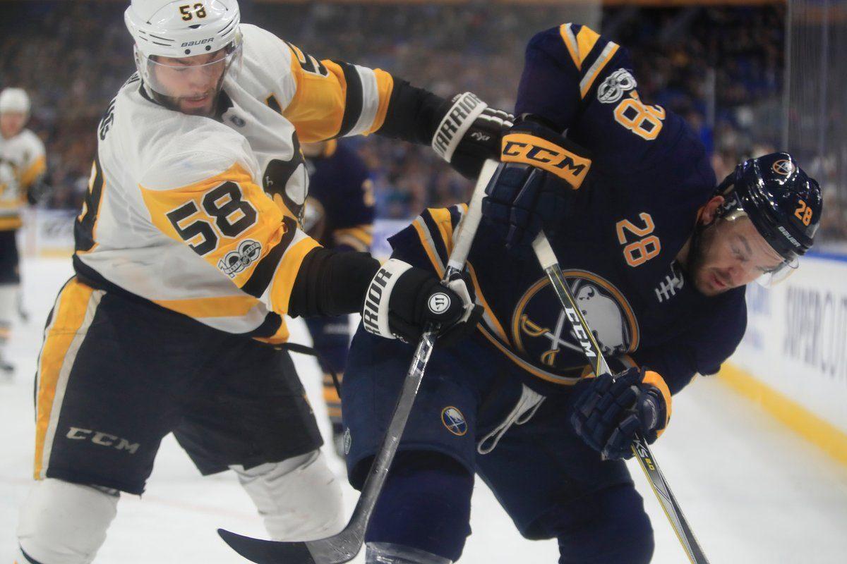 Zemgus Girgensons works against Penguins defenseman Kris Letang Friday night in KeyBank Center (Harry Scull Jr./Buffalo News).