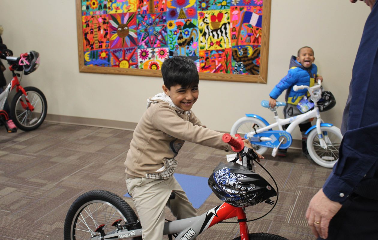 M&T Bank employees surprised some kids at Journey's End with new bicycles as gifts. (M&T Bank photo)