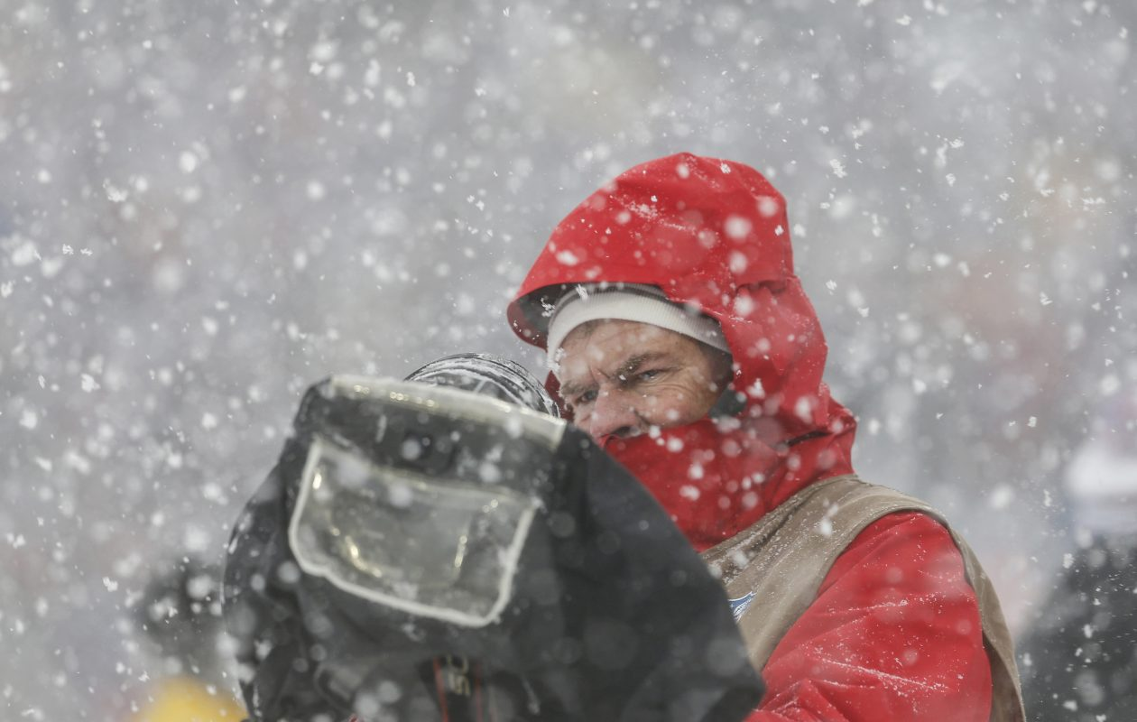 Buffalo News photographer James P.  McCoy works through the snow (Timothy T. Ludwig/USA TODAY Sports)