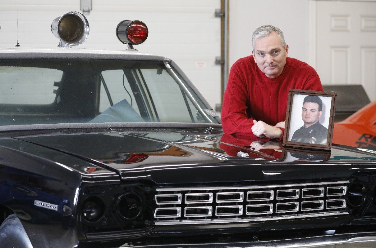 After retiring as chief of Internal Affairs, Inspector Harold McLellan will have more time to work on his 1968 'Adam-12' police car. But he'll always remember his brother, Robert, a police officer who was killed while chasing a suspect in 1998. (Derek Gee/Buffalo News)