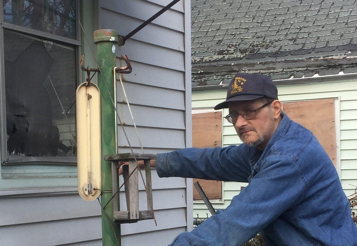 Edward Bald, 61, of Quincy Street, points out the bedroom window of his home out of which he fired his shotgun after a rock was thrown through it. (Jane  Kwiatkowski/News file photo)