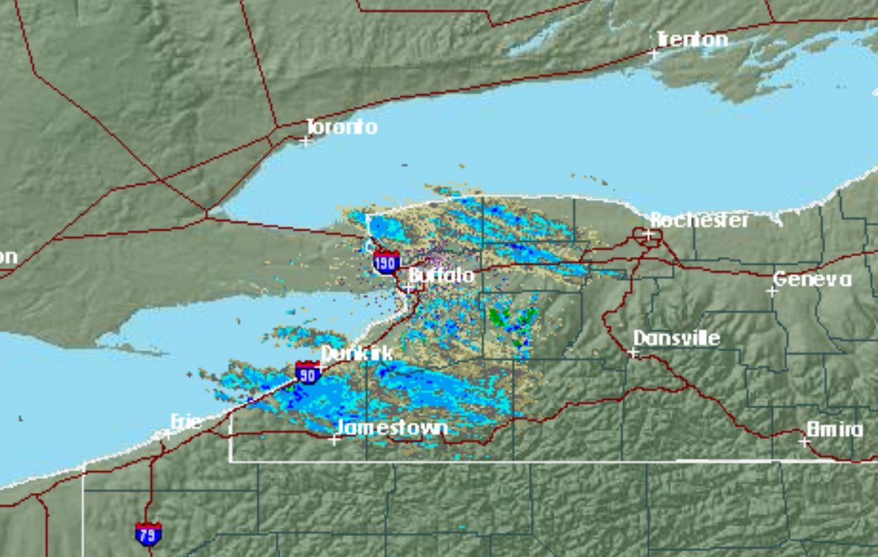 Lake-effect snow streamers off of Lake Erie and Lake Ontario continued about noon today. (National Weather Service radar)
