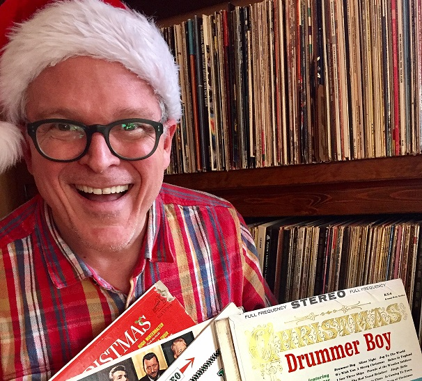 John Morris Russell and a tiny portion of his Christmas record collection.