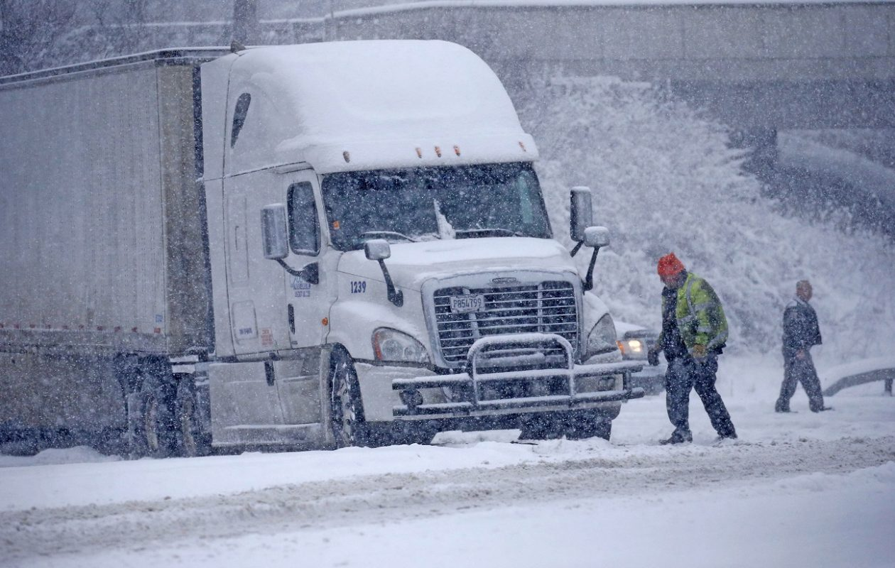 Authorities try to figure out how to remove a tractor-trailer that is blocking an exit ramp in Elma on Thursday.  (Robert Kirkham/Buffalo News)
