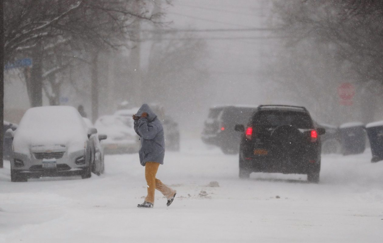 A pedestrian braves the blowing snow on Hamilton Street in the Black Rock neighborhood of Buffalo Friday. (Mark Mulville/Buffalo News)
