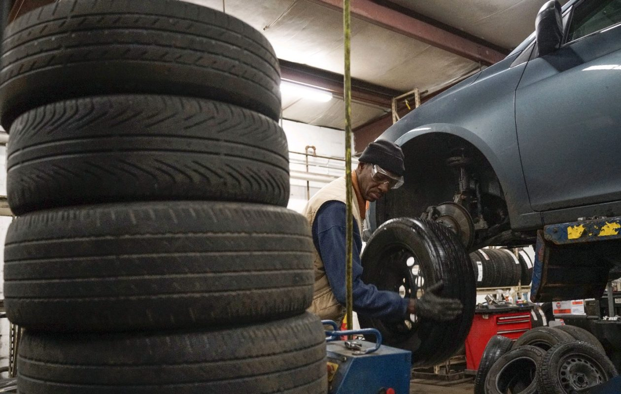 Tire Technician Ed Baker installs a snow tire for a customer at Ben's Downtown Tire on Sycamore Street. (Derek Gee/Buffalo News)