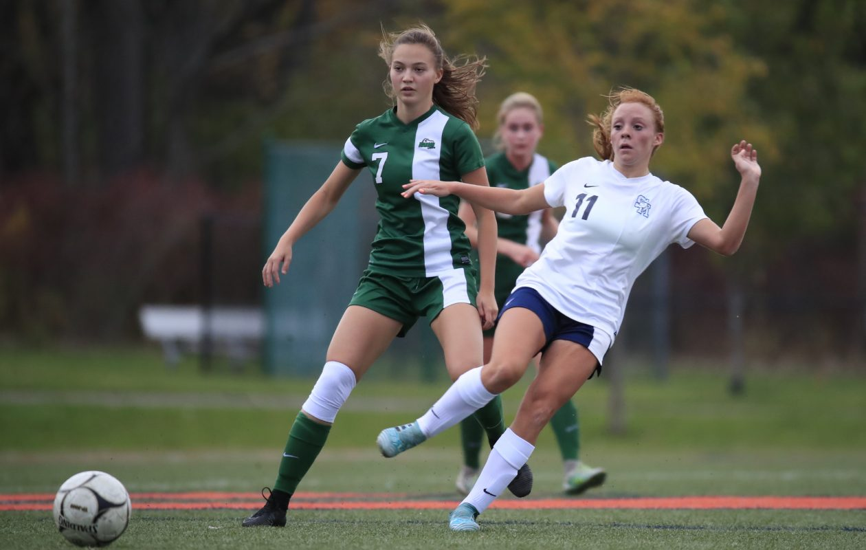 St. Mary's Skylar Baun passes the ball in front of fellow All-Catholic player Olivia Jerge of Nardin during first half action this past season. (Harry Scull Jr./ Buffalo News)