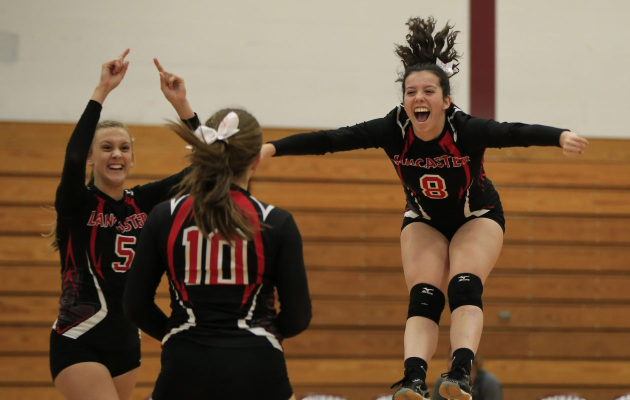 Lancaster's Julia Kurowski and Samantha Moll celebrate a winning point against Orchard Park during Section VI Class AA semifinals. (Harry Scull Jr./ Buffalo News)