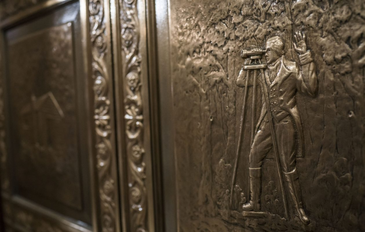 By the Ellicott Square Building elevators can be found a detail of a surveyor, representing the building's namesake: Joseph Ellicott. (Derek Gee/Buffalo News)