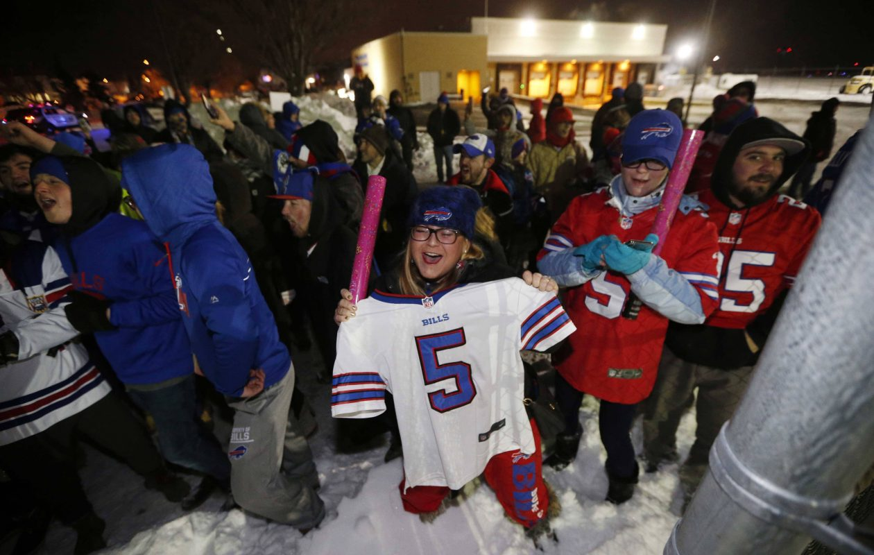 Bills fans excited for the postseason prepare to greet the team as they arrive home from Miami at the Air Cargo Center at the Buffalo Niagara International Airport in Cheektowaga, Monday, Jan. 1, 2018.  (Derek Gee/Buffalo News)