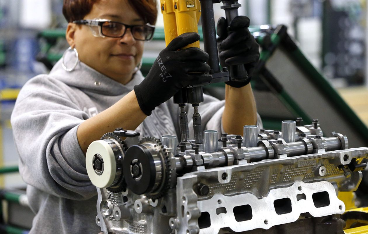 A worker sets screws on the four-cylinder line at the GM Tonawanda Engine Plant.  (Derek Gee/Buffalo News)