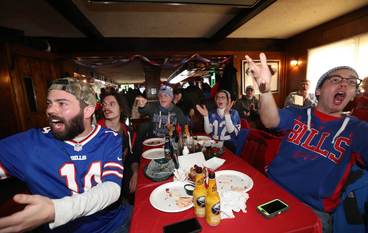 The Scheffler family watched the Bills-Jaguars playoff game at the Big Tree Inn in Orchard Park. (Sharon Cantillon/Buffalo News)