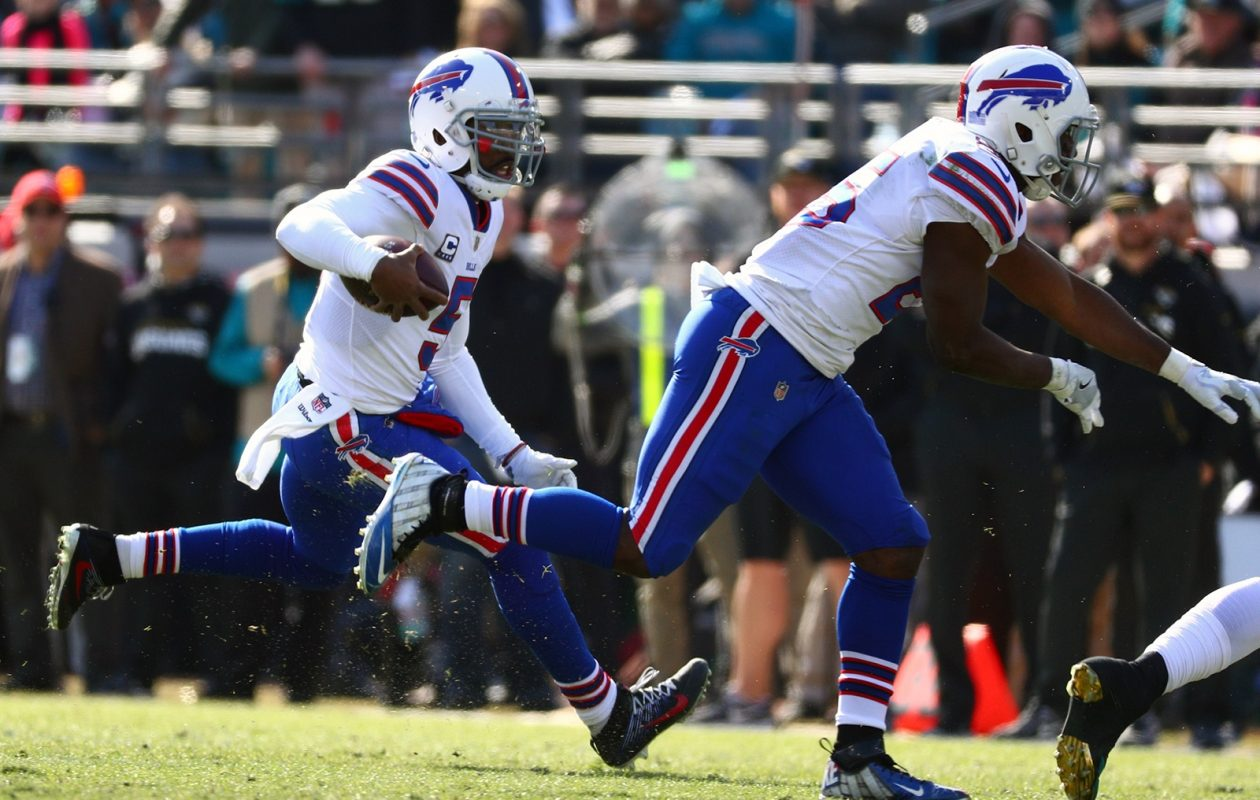 Tyrod Taylor rushes for a first down in the first half. (James P. McCoy/Buffalo News)