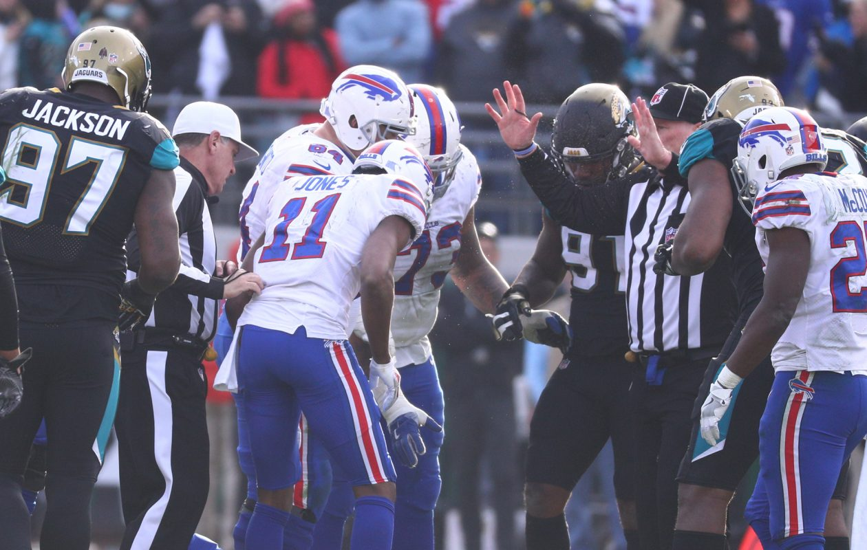 Buffalo Bills quarterback Tyrod Taylor (5) is sacked and knocked out of the game by Jacksonville Jaguars defensive end Dante Fowler (56) in the fourth quarter at EverBank Field in Jacksonville, Fla., on Sunday, Jan. 7, 2018. (James P. McCoy/Buffalo News)