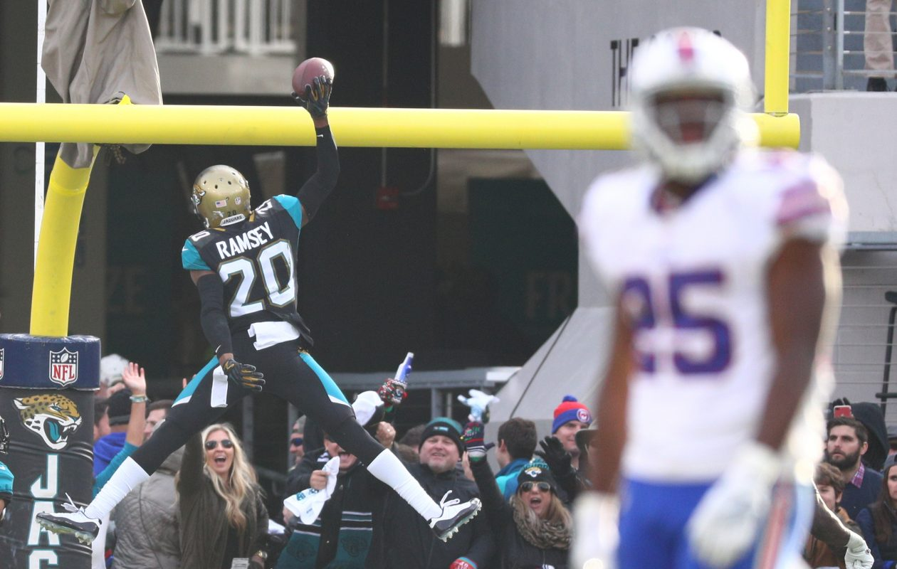 Jacksonville Jaguars cornerback Jalen Ramsey (20) spikes the ball over the goal post after his game-clinching interception in the fourth quarter while Buffalo Bills running back LeSean McCoy (25) walks off the field. (James P. McCoy / Buffalo News)