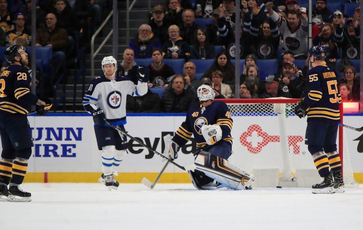 The Sabres' Zemgus Girgensons (28), Robin Lehner and Rasmus Ristolainen (55) have a sadder reaction that Winnipeg's Kyle Connor. (Harry Scull Jr./Buffalo News)