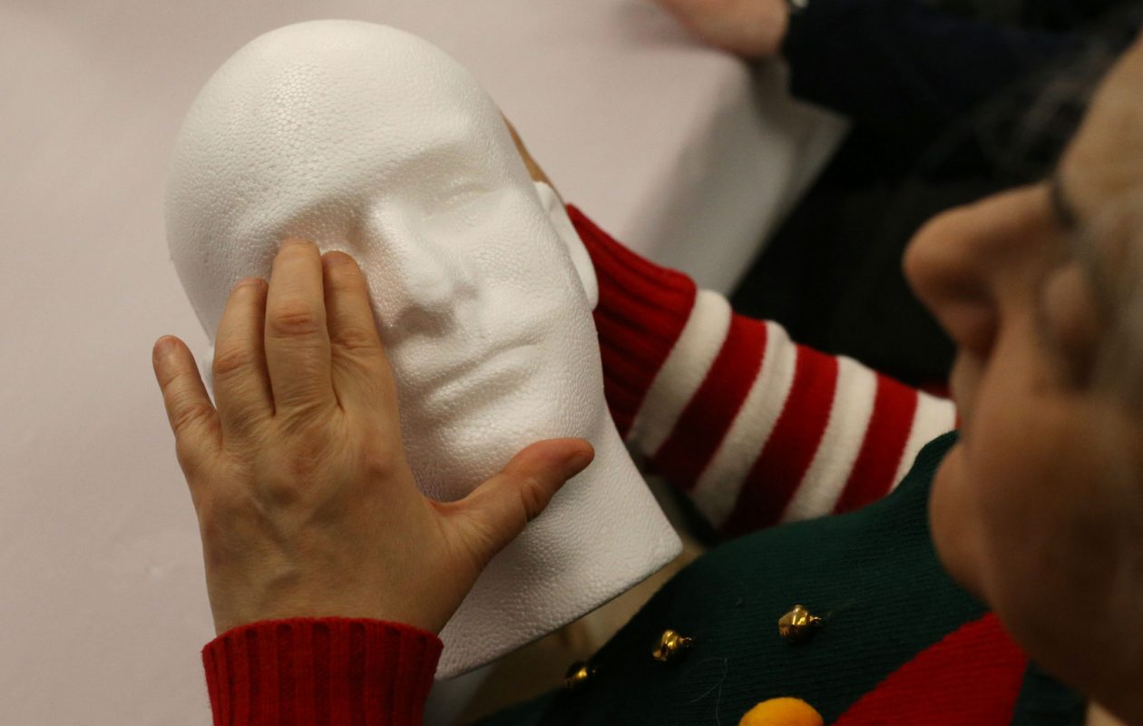 Linda Lazzaro uses her hands to examine a foam bust during an art activity based on the work of George Segal in the Albright-Knox Art Gallery .  (Derek Gee/Buffalo News)