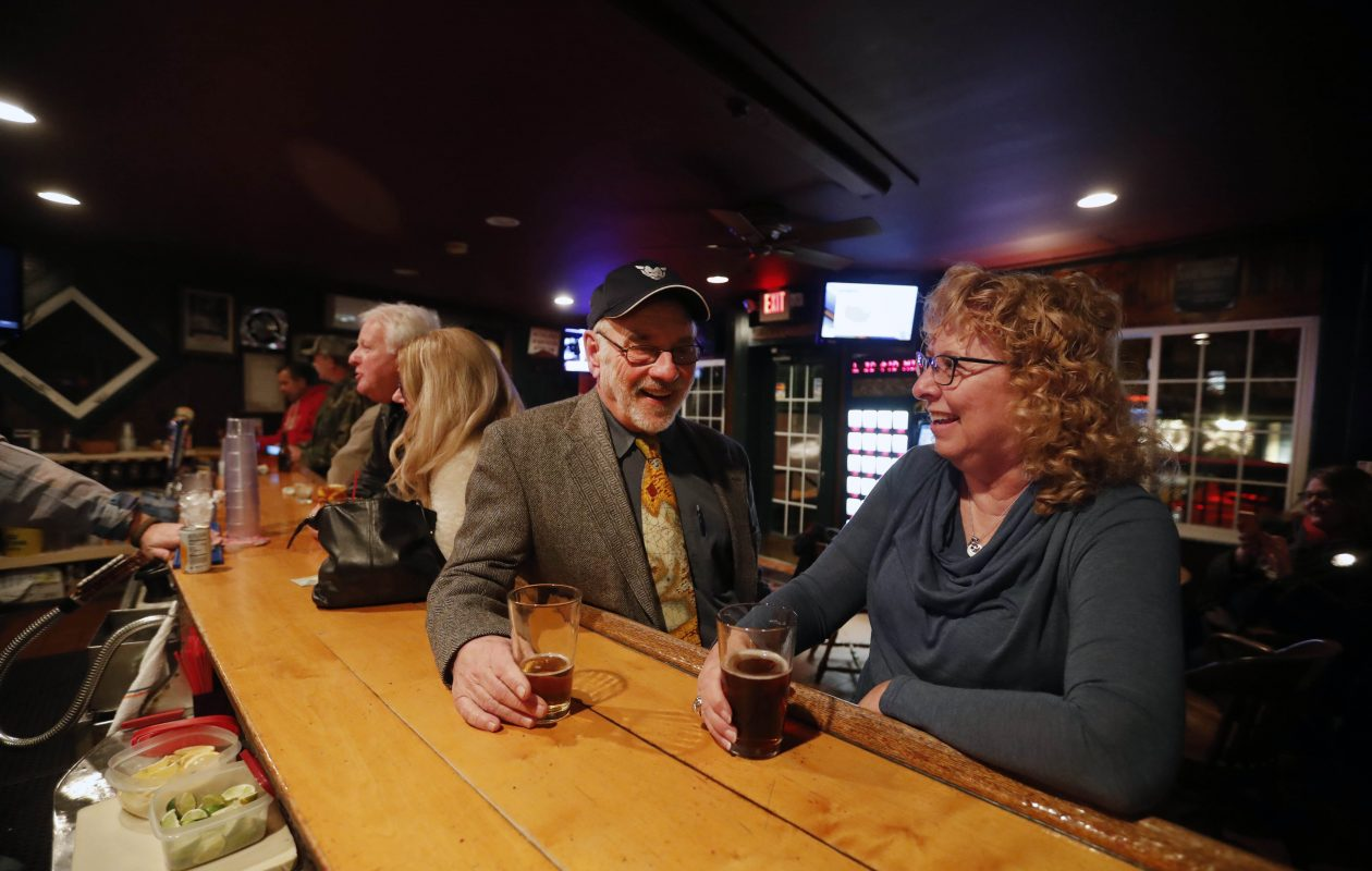 Rick Ohler and Karen Wielinski talk over a pint at East Aurora's Wallenwein Hotel, where Ohler and his writing students often end up after a class. (Mark Mulville/Buffalo News)