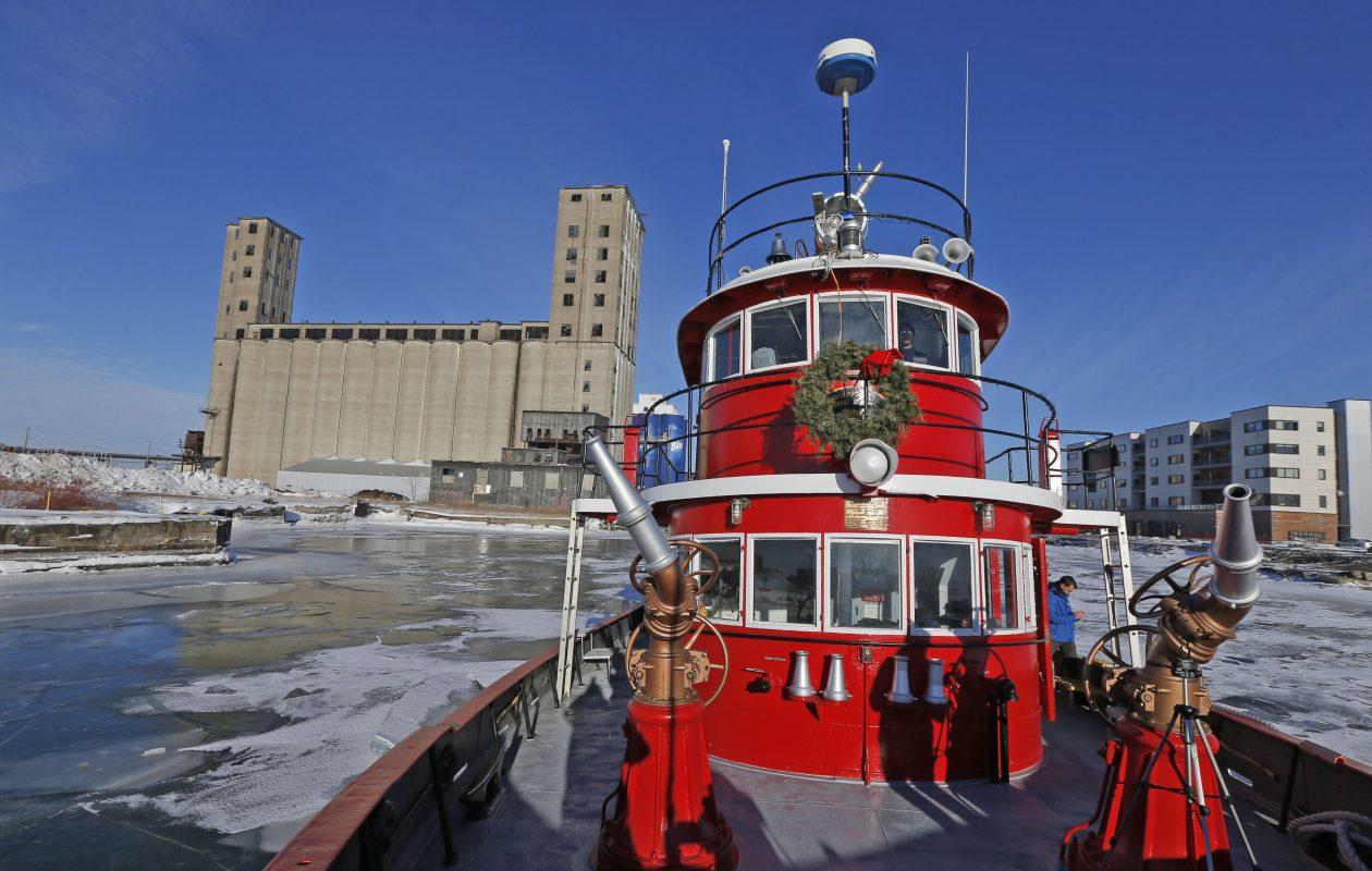 The Edward M. Cotter Buffalo fireboat broke up the ice surface on the Buffalo River on Wednesday, Jan. 10, 2018.  (Robert Kirkham/Buffalo News)