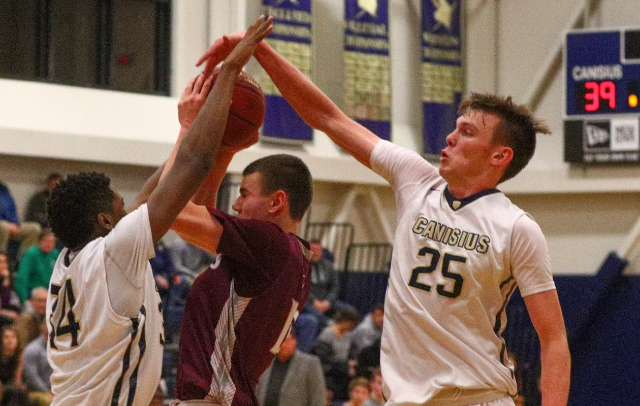 Canisius' Ryan Bradley blocks a shot by St. Joe's Kevin Durkin during Tuesday's Monsignor Martin High School Athletic Association clash between the rivals at Canisius High School. Bradley finished with a game-high 32 points and added 12 boards. (James P. McCoy / Buffalo News)