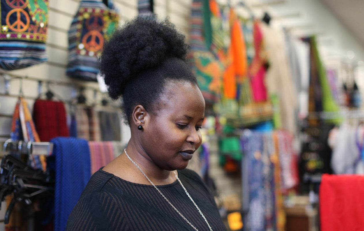 Gysma Kueny fled her native South Sudan amid civil war and made it to Buffalo as a refugee 15 years ago.  She now runs her own business, Gysma's African Style, at the West Side Bazaar  Many of the items she sells are made by family members and friends who still live in South Sudan.  (Derek Gee/Buffalo News)