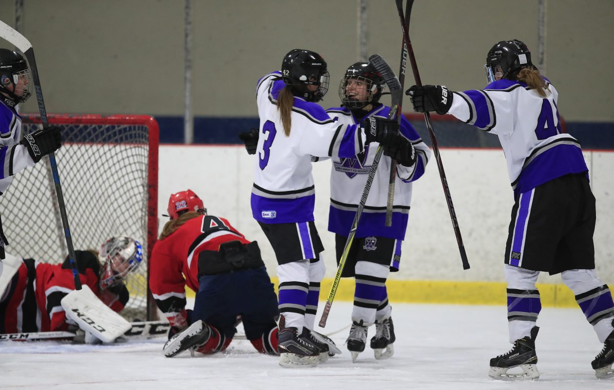 Monsignor Martin's Emily Matthew celebrates her goal against Lancaster/Iroquois/Depew during first period action at Holiday Twin Rinks on Tuesday (Harry Scull Jr./ Buffalo News)