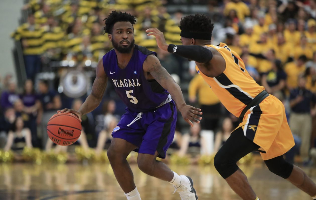 Niagaras James Towns looks for room to maneuver against Canisius. Towns struck for 31 points in the Purple Eagles victory.