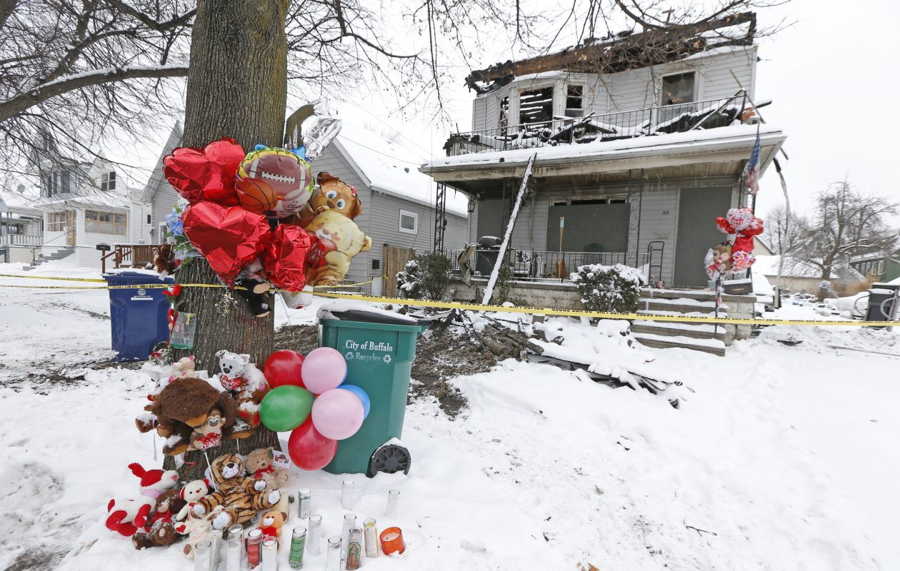 The tree in front of the Benzinger Street home where a fatal fire occurred is decorated with items as a memorial to the tragedy on Tuesday, Jan. 30, 2018. (Robert Kirkham/Buffalo News)
