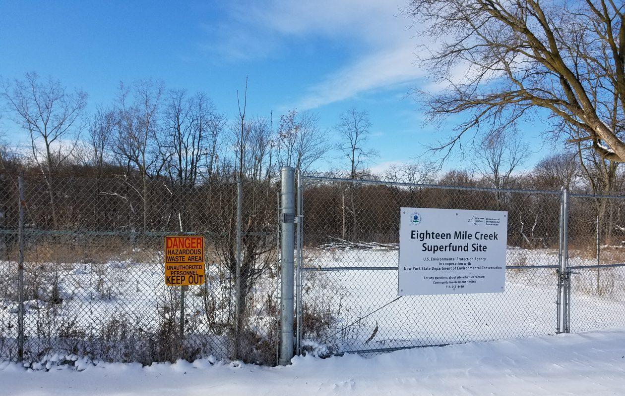 A fence surrounds the Eighteen Mile Creek Corridor Superfund site on Mill Street in Lockport on Jan. 3, 2018. (Thomas J. Prohaska/Buffalo News)