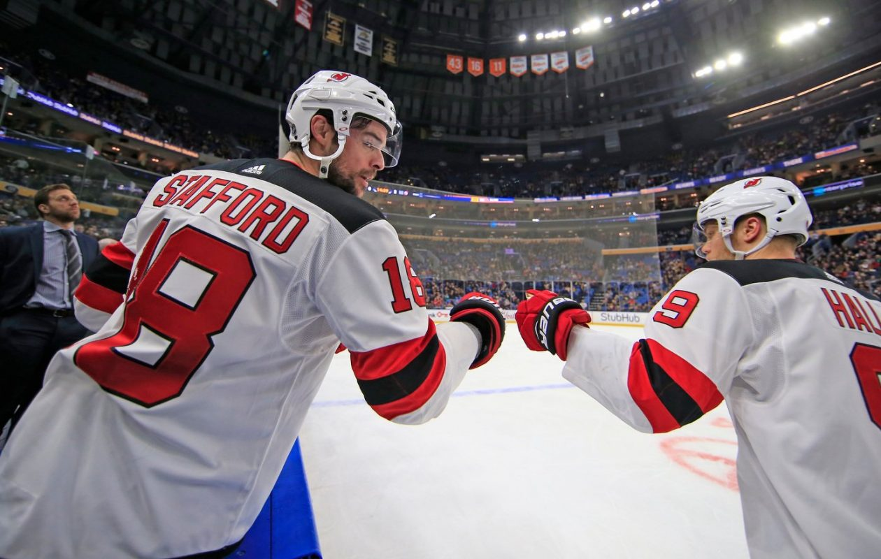 The Devils' Drew Stafford and Taylor Hall celebrated more than the Sabres in Buffalo's arena Tuesday. (Harry Scull Jr./Buffalo News)