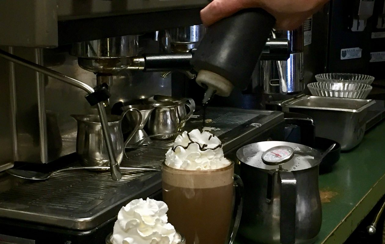 Steamed milk and chocolate syrup, topped with real whipped cream and a drizzle of chocolate are the ingredients to a good hot chocolate at Hamburg's Comfort Zone Cafe. (Elizabeth Carey/Special to The News.)
