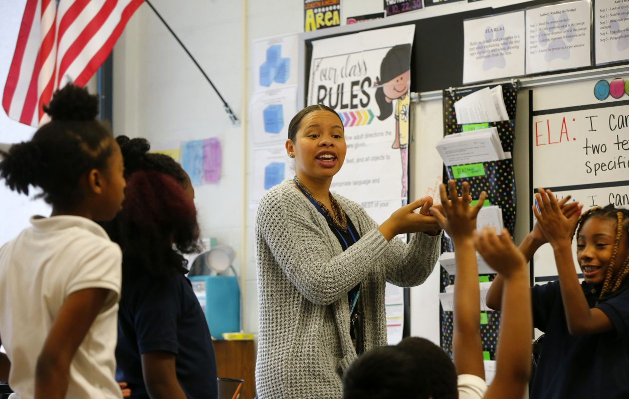 Fourth-grade teacher Tiffany Bryant works with her students on a science lesson at BUILD Academy in Buffalo. (Mark Mulville/Buffalo News)