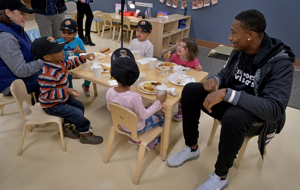 Bengals safety George Iloka sits with a table of preschoolers from  The Children's Home of Cincinnati as they enjoys Duff's Famous Wings donated by the Buffalo Bills. (Glenn Hartong/Special to The News)