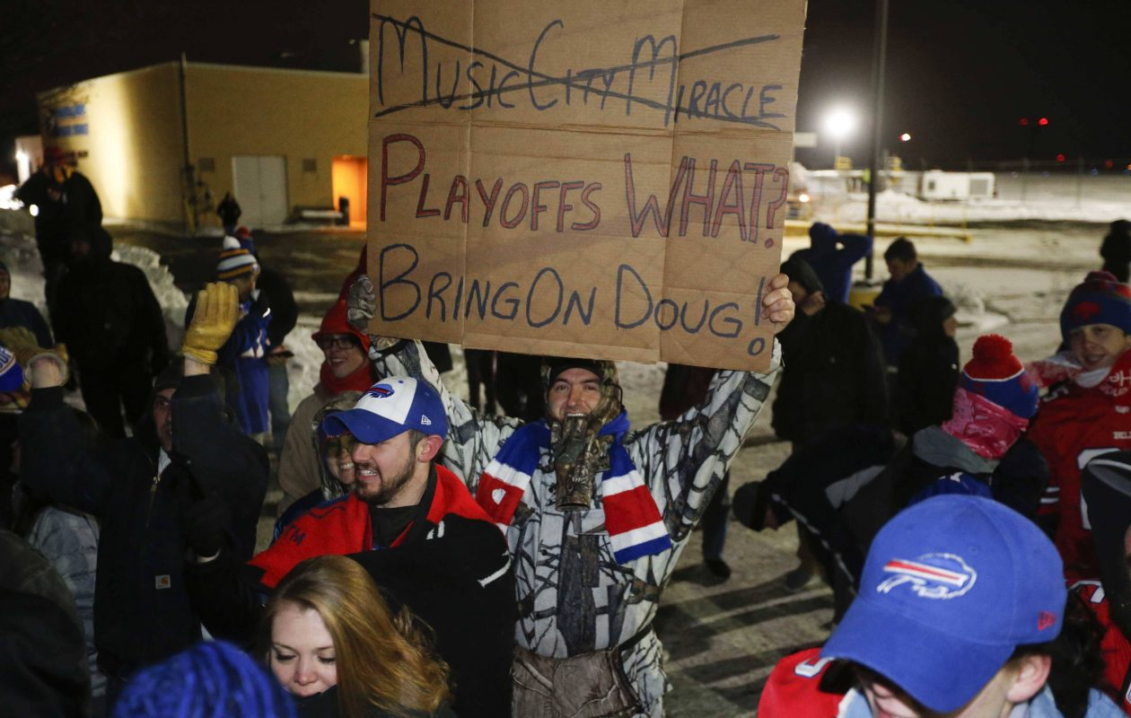 Bills fans wait for the team to arrive at the Air Cargo Center at the Buffalo Niagara International Airport in Cheektowaga, Monday, Jan. 1, 2018.  (Derek Gee/Buffalo News)