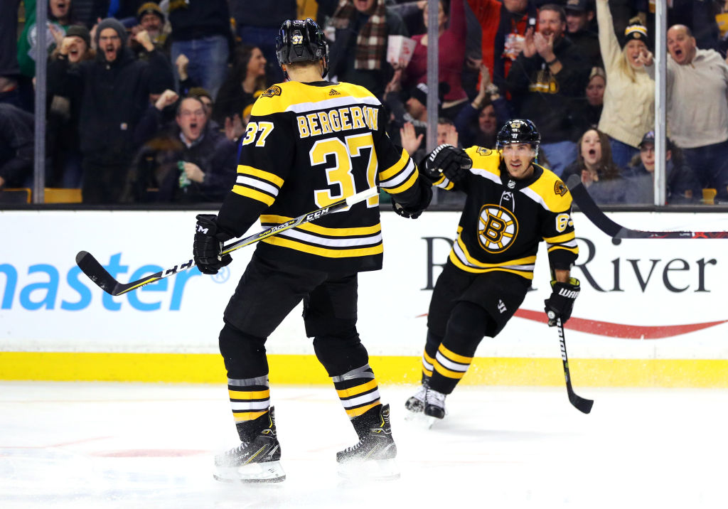 Brad Marchand and Patrice Bergeron (37) have done a lot of celebrating during the Bruins' 17-3-3 burst (Getty Images).