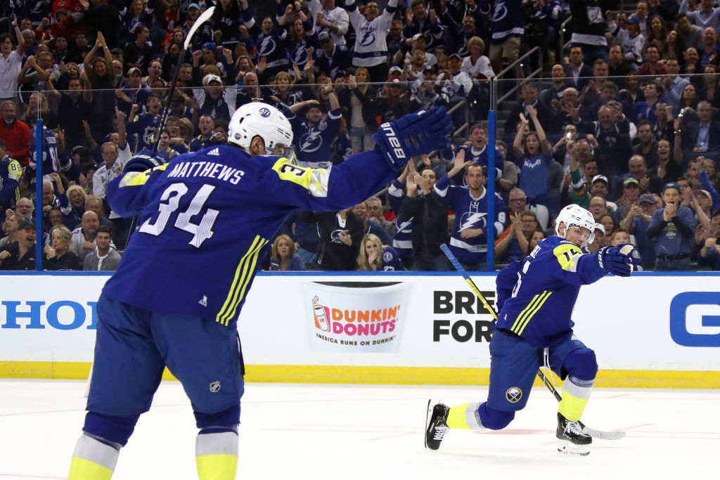 The Referee: Auston Matthews, left, and Jack Eichel call it a goal Sunday in Amalie Arena. (Getty Images)