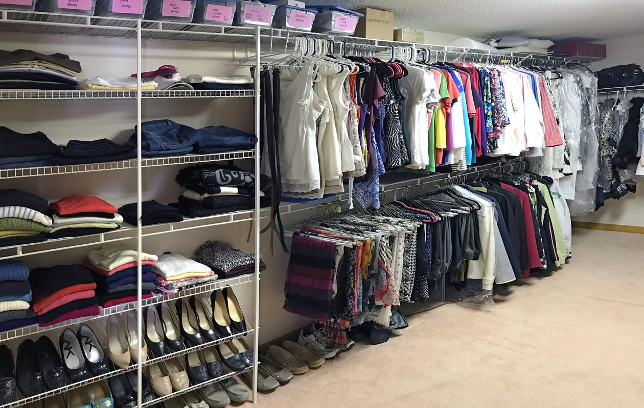 Michelle Panzer organized this closet by grouping like items together; adding shelving for sweater and shoe storage; and using two rows for hanging clothes. (Michelle Panzer)