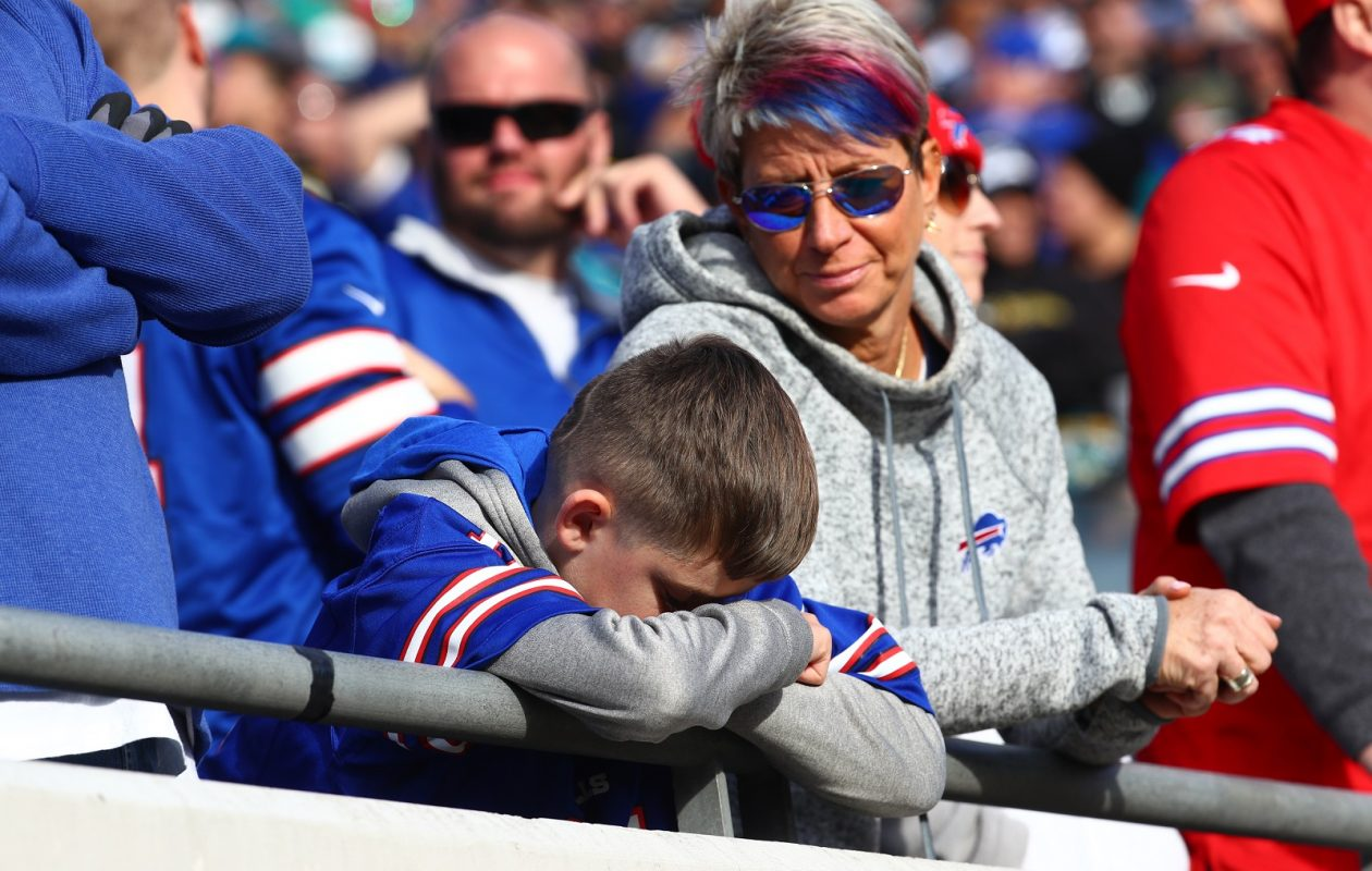 Louise Sanders of South Carolina, looks at her son Jackson, who watched in person as the Buffalo Bills lost their first playoff game in 18 years to the Jacksonville Jaguars. (James P. McCoy / Buffalo News)