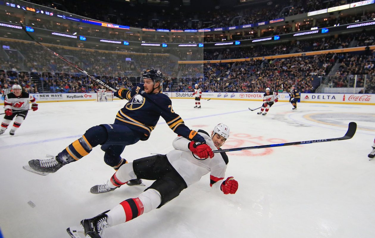 The Sabres' Scott Wilson and the Devils' Brian Boyle go for a ride Tuesday. (Harry Scull Jr./Buffalo News)