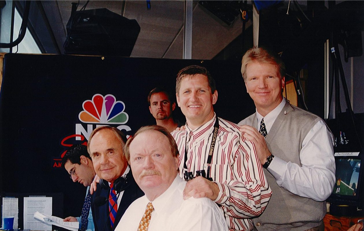 Michael Gluc, third from left, worked as a spotter for Dick Enberg, left, for five seasons. Here the two are joined at Super Bowl XXXII by former Bills punter and analyst Paul Maguire, seated, and former Giants quarterback Phil Simms. (Courtesy of Michael Gluc)