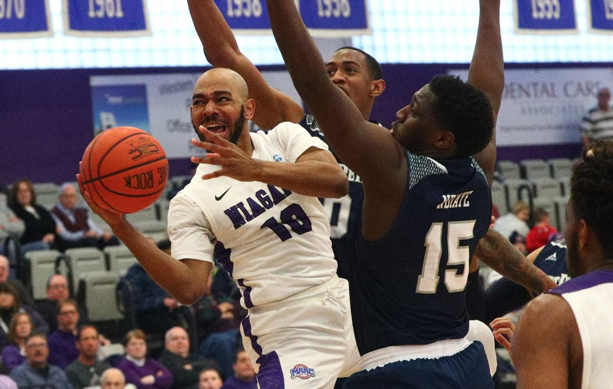 Niagara Purple Eagles guard Kahlil Dukes (10) scores two points over Saint Peters Peacocks forward Mamadou Ndiaye (15) in the second half at Niagara Universitys Gallagher Center on Sunday, Jan. 14, 2018.  (James P. McCoy/Buffalo News)