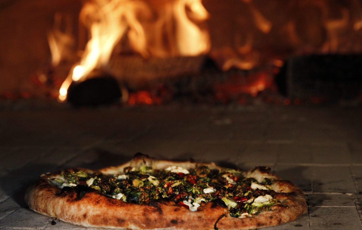 A brussels sprouts and pancetta pizza in the wood-fired oven at the Elm Street Bakery in East Aurora.  (Sharon Cantillon/Buffalo News)