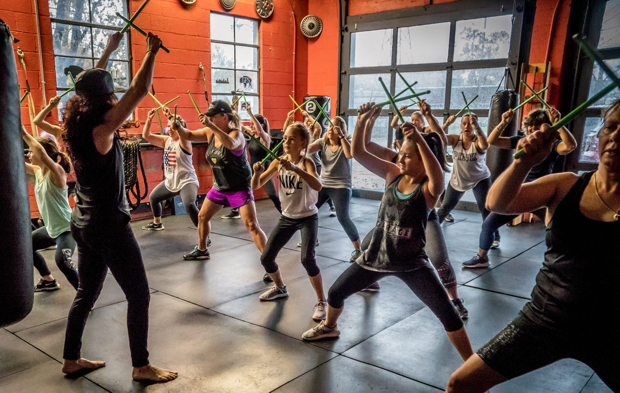 Judy Siniscalchi, owner of Garage Fitness Studio in Angola, leads a drumstick-based workout.  (Alicia Wittman)