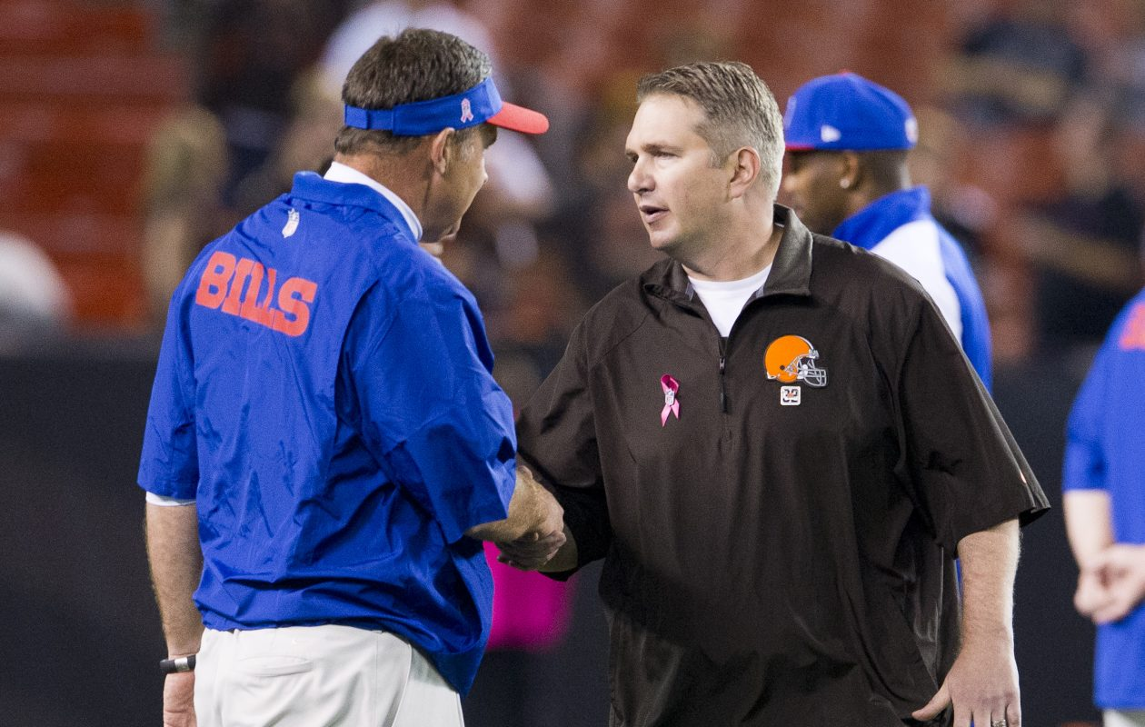 One possible replacement for current Bills OC Rick Dennison is Colts OC Rob Chudzinski, shown here shaking hands with then-Bills coach Doug Marrone. (Jason Miller/Getty Images file photo)