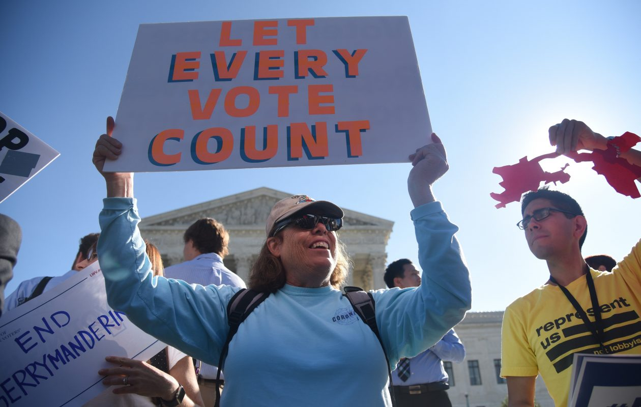 Demonstrators gather outside of The United States Supreme Court during an oral arguments in Gill v. Whitford to call for an end to partisan gerrymandering on October 3, 2017 in Washington, DC. (Photo by Olivier Douliery/Getty Images)