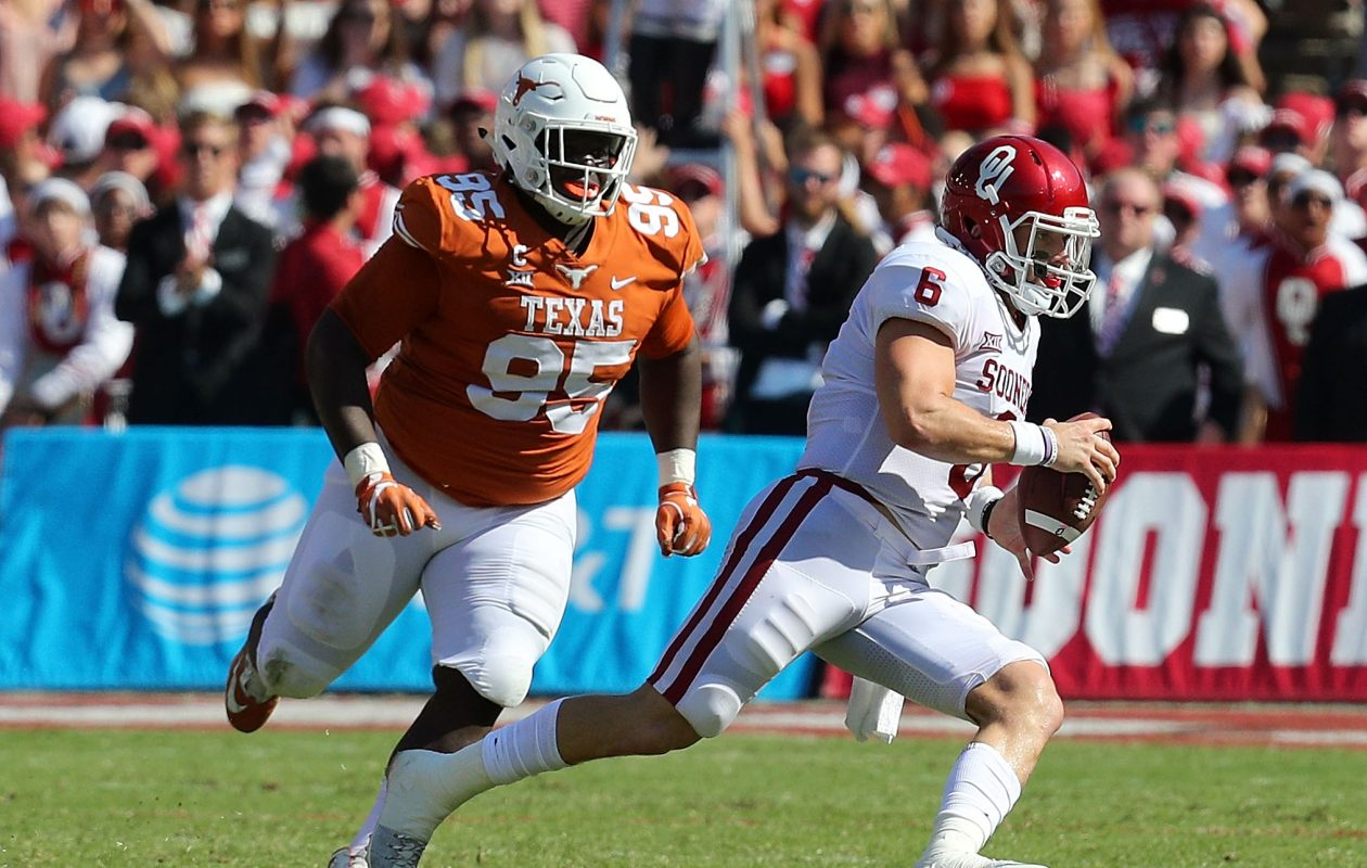 Texas' Poona Ford chases Oklahoma's Baker Mayfield. (Richard W. Rodriguez/Getty Images)